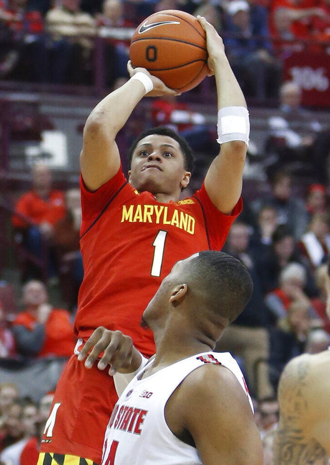 Maryland's Anthony Cowan, top, pulls up for a shot as Ohio State's Kaleb Wesson watches during the first half of an NCAA college basketball game Friday, Jan. 18, 2019, in Columbus, Ohio. Maryland won 75-61. (AP Photo/Jay LaPrete)
