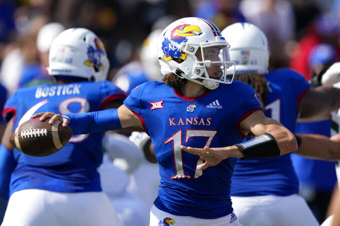 Kansas quarterback Jason Bean (17) passes to a teammate during the first half of an NCAA college football game against Baylor in Lawrence, Kan., Saturday, Sept. 18 2021. (AP Photo/Orlin Wagner)