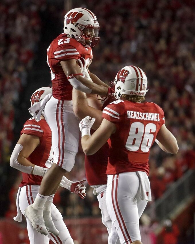 Wisconsin's Jonathan Taylor (23) celebrates his touchdown run with teammates during the first half of an NCAA college football game against Nebraska Saturday, Oct. 6, 2018, in Madison, Wis. (AP Photo/Morry Gash)
