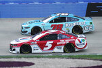 Winning driver Kyle Larson (5) passes BJ McLeod (78) in the final laps at Nashville Superspeedway during a NASCAR Cup Series auto race Sunday, June 20, 2021, in Lebanon, Tenn. (AP Photo/Mark Humphrey)