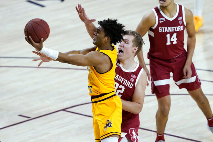 Arizona State guard Remy Martin drives past Stanford forward Lukas Kisunas (32) during the first half of an NCAA college basketball game Saturday, Jan. 30, 2021, in Tempe, Ariz. (AP Photo/Matt York)