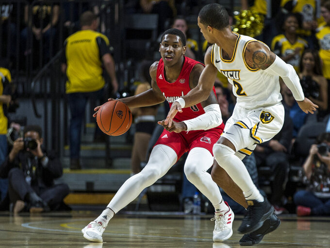 CORRECTS TO JACKSONVILLE STATE GUARD DERRICK COOK NOT JAMALL GREGORY - Jacksonville State guard Derrick Cook (0) dribbles as Virginia Commonwealth guard Marcus Evans (2) plays defense during the first half of an NCAA college basketball game Sunday, Nov. 17, 2019 in Richmond, Va.  (AP Photo/Zach Gibson)
