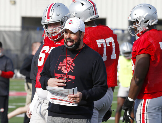 """FILE - Ohio State coach Ryan Day yells during an NCAA college football practice in Columbus, Ohio, in this Monday, April 5, 2021, file photo. There will be no easing into the season for most Big Ten teams. Ohio State coach Ryan Day was non-committal when asked if he liked playing a conference opener. """"I'll tell you after Thursday night's game,"""" he said. (AP Photo/Paul Vernon, File)"""
