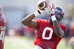 Mississippi NCAA college football linebacker Lakia Henry (0) reaches for a pass during practice in Oxford, Miss., Monday, Aug. 9, 2021. (AP Photo/Rogelio V. Solis)