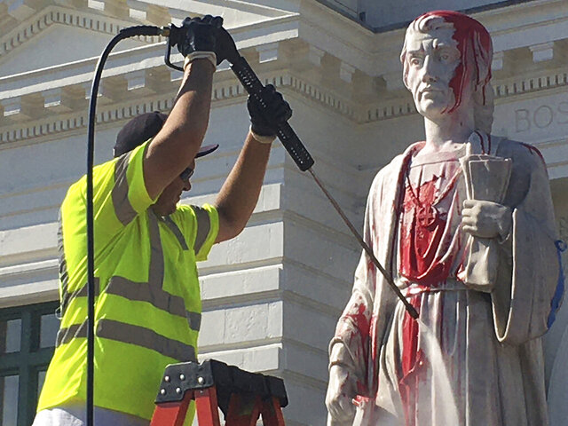 The statue of Christopher Columbus that stands in front of Union Station in Worcester, Mass., was vandalized early Tuesday morning June 23, 2020. (George Barnes/Worcester Telegram & Gazette via AP)