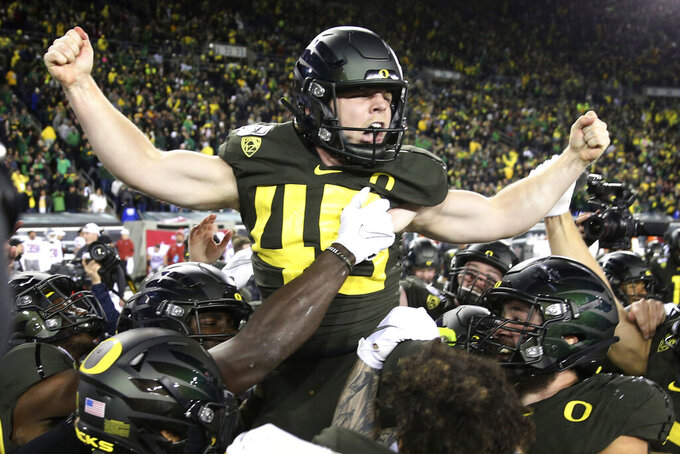 Oregon kicker Camden Lewis is carried off the field by his teammates after kicking the winning field goal against Washington State in an NCAA college football game Saturday, Oct. 26, 2019, in Eugene, Ore. (AP Photo/Chris Pietsch)