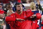 Mississippi head coach Matt Luke signals to his players during the second half of an NCAA college football game against New Mexico State in Oxford, Miss., Saturday, Nov. 9, 2019. (AP Photo/Rogelio V. Solis)