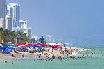 Beachgoers enjoyed the sunny and hot day at Sunny Isles Beach as the coronavirus pandemic continues on Sunday, Sept. 6, 2020. (David Santiago/Miami Herald via AP)