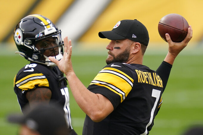 Pittsburgh Steelers quarterback Ben Roethlisberger (7) and wide receiver Diontae Johnson (18) warm up before an NFL football game against the Philadelphia Eagles, Sunday, Oct. 11, 2020, in Pittsburgh. (AP Photo/Keith Srakocic)