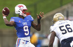 FILE - In this Sept. 22, 2018, file photo, SMU quarterback William Brown (9) fires off a pass over Navy linebacker Nizaire Cromartie (56) during the second quarter of an NCAA college football game, in Dallas. SMU plays against UCF on Saturday. (Ryan Michalesko/The Dallas Morning News via AP, File)