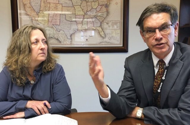 Jerry Kruse, right, dean and provost of the Southern Illinois University School of Medicine, discusses SIU's pilot project with the Illinois Department of Corrections to provide inmate health care at two prisons with Dawn DeFraties, executive director of SIU's Office of Correctional Medicine, in this Monday, Feb. 17, 2020 photo. Defraties is responsible for the health care initiative that will begin this summer, add two prisons early next year, and eventually could expand statewide. (AP Photo/John O'Connor)