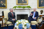 President Joe Biden, right, meets with Jordan's King Abdullah II, left, in the Oval Office of the White House in Washington, Monday, July 19, 2021. (AP Photo/Susan Walsh)