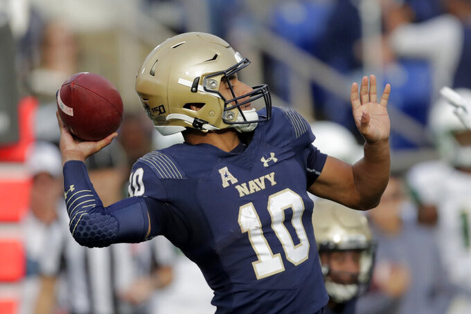 Navy quarterback Malcolm Perry throws a pass against South Florida during the first half of an NCAA college football game, Saturday, Oct. 19, 2019, in Annapolis. (AP Photo/Julio Cortez)