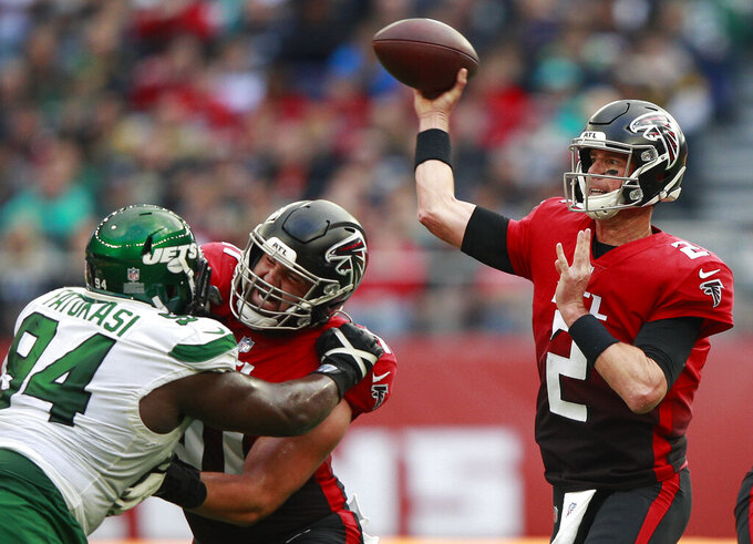 Atlanta Falcons quarterback Matt Ryan (2) passes the ball during an NFL football game between the New York Jets and the Atlanta Falcons at the Tottenham Hotspur stadium in London, England, Sunday, Oct. 10, 2021. (AP Photo/Ian Walton)
