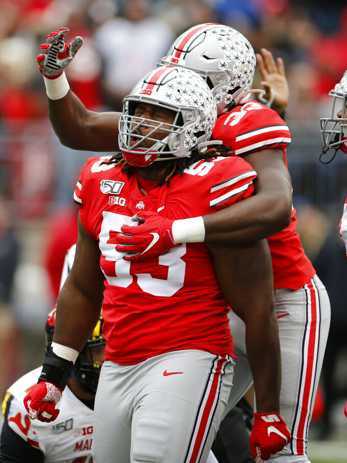 Ohio State defensive lineman Davon Hamilton, front, celebrates his sack against Maryland with teammate running back Zach Harrison during the first half of an NCAA college football game, Saturday, Nov. 9, 2019, in Columbus, Ohio. (AP Photo/Jay LaPrete)