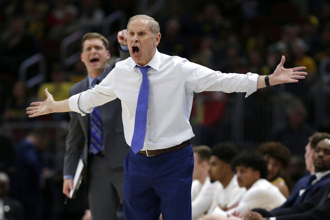 Michigan head coach John Beilein argues a call during the second half of an NCAA college basketball game against Iowa in the quarterfinals of the Big Ten Conference tournament, Friday, March 15, 2019, in Chicago. (AP Photo/Kiichiro Sato)