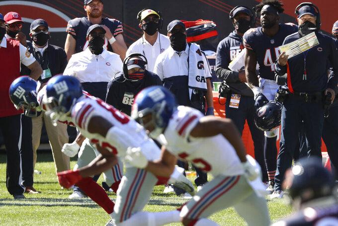 Chicago Bears head coach Matt Nagy, back center, watches the fourth quarter of an NFL football game against the New York Giants, Sunday, Sept. 20, 2020, in Chicago. (John J. Kim/Chicago Tribune via AP)