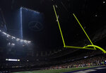 FILE - In this Feb. 3, 2013, file photo, half the lights are out in the Superdome during a power outage in the second half of the NFL Super Bowl XLVII football game between the San Francisco 49ers and Baltimore Ravens, in New Orleans. (AP Photo/Marcio Sanchez, File)