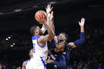 Tulsa guard Elijah Joiner (3) shoots as Connecticut guard Alterique Gilbert (3) and forward Isaiah Whaley, rear, defend, during the second half of an NCAA college basketball game in Tulsa, Okla., Thursday, Feb. 6, 2020. (AP Photo/Sue Ogrocki)
