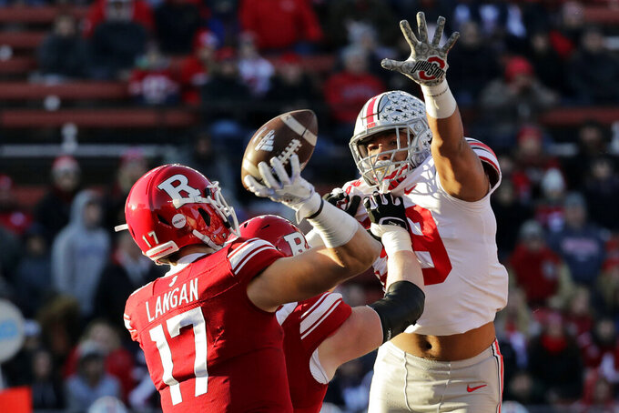 Ohio State linebacker Malik Harrison pressures Rutgers quarterback Johnny Langan during the first half of an NCAA college football game Saturday, Nov. 16, 2019, in Piscataway, N.J. Ohio State won 56-21. (AP Photo/Adam Hunger)