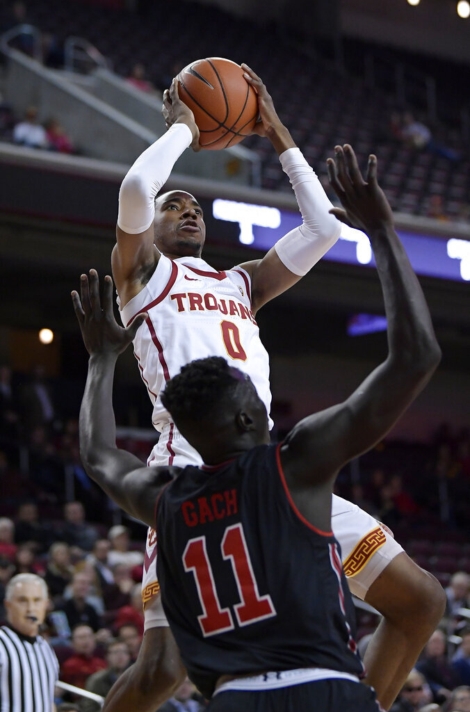 Southern California guard Shaqquan Aaron shoots as Utah forward Both Gach defends during the first half of an NCAA college basketball game Wednesday, Feb. 6, 2019, in Los Angeles. (AP Photo/Mark J. Terrill)