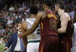 Boston Celtics coach Brad Stevens, left, races to separate guard Marcus Smart, second from left, from Cleveland Cavaliers guard JR Smith, hidden from view behind Cavaliers center Tristan Thompson (13), during the second half in Game 2 of the NBA basketball Eastern Conference finals, Tuesday, May 15, 2018, in Boston. Smith was called for a flagrant foul for shoving Celtics forward Al Horford while he was in the air shooting the ball. (AP Photo/Charles Krupa)