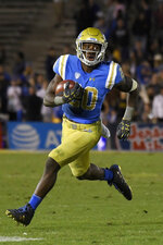 FILE - In this Nov. 24 ,2017, file photo, UCLA running back Brandon Stephens runs against California during the second half of an NCAA college football game, in Los Angeles. Stephens, from Plano, Texas, is back in Texas after transferring to SMU. (AP Photo/Mark J. Terrill, File)