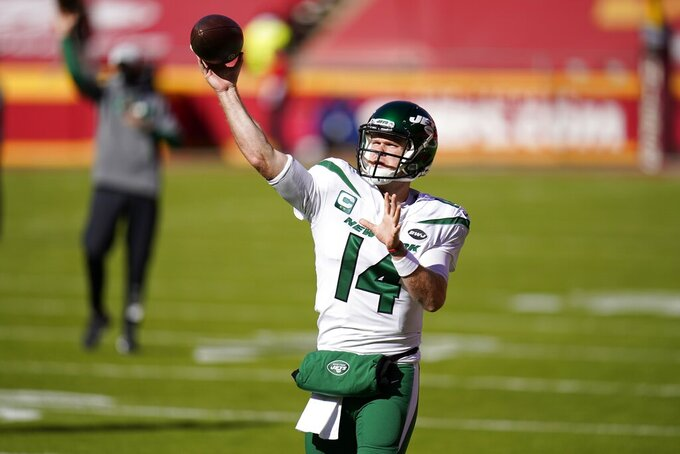 New York Jets quarterback Sam Darnold (14) throws during warmups before an NFL football game against the Kansas City Chiefs on Sunday, Nov. 1, 2020, in Kansas City, Mo. (AP Photo/Jeff Roberson)