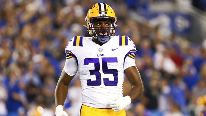 LSU running back Nick Demas (35) walks onto the field during the first half of the team's NCAA college football game against Kentucky in Lexington, Ky., Saturday, Oct. 9, 2021. (AP Photo/Michael Clubb)