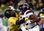 FILE - In this Nov. 16, 2019, file photo, Oregon's Kayvon Thibodeaux, left, tackles Arizona's Brian Casteel during the third quarter of an NCAA college football game, in Eugene, Ore. Thibodeaux was selected to The Associated Press Preseason All-America first team defense, Monday Aug. 23, 2021. (AP Photo/Chris Pietsch, File)