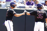 East Carolina's Spencer Brickhouse, left, celebrates with Bryson Worrell (35) after scoring on a wild pitch in the third inning against Campbell in an NCAA college baseball tournament regional game in Greenville, N.C., Monday, June 3, 2019. (Ethan Hyman/The News & Observer via AP)