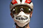 Italy's Elia Viviani wears a face mask reading