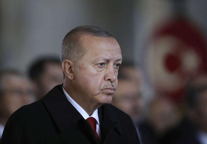 Turkey's President Recep Tayyip Erdogan stands during a ceremony commemorating Mustafa Kemal Ataturk on the 81st anniversary of his death at his mausoleum, in Ankara, Turkey, Sunday, Nov. 10, 2019. Tens of thousand of people visit his mausoleum to pay their respects to Ataturk, founder of modern Turkey, considered as the nation's father. (AP Photo/Burhan Ozbilici)