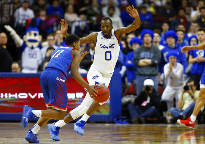 Seton Hall's Quincy McKnight (0) defends against DePaul's Charlie Moore (11) during the second half of an NCAA college basketball game Wednesday, Jan. 29, 2020, in Newark, N.J. (AP Photo/Noah K. Murray)
