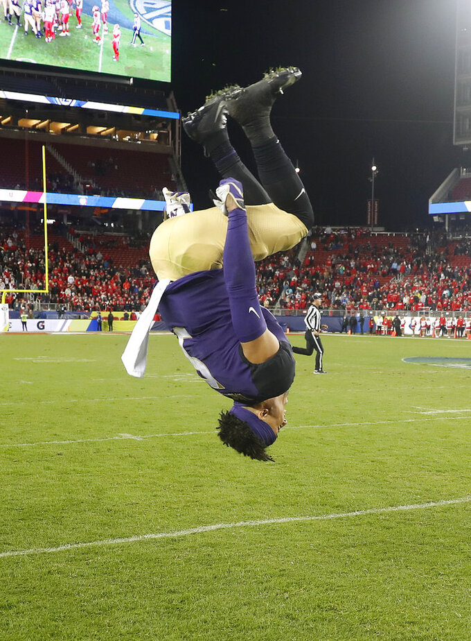Washington wide receiver Andre Baccellia does a backflip after Washington defeated Utah 10-3 in the Pac-12 Conference championship NCAA college football game in Santa Clara, Calif., Friday, Nov. 30, 2018. (AP Photo/Tony Avelar)