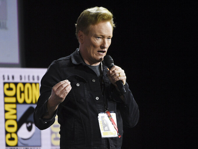 """FILE - In this July 18, 2019, file photo, Conan O'Brien introduces Tom Cruise to present a clip from """"Top Gun: Maverick"""" on day one of Comic-Con International in San Diego. Six of America's late-night television comedy hosts - five of them white men - turned serious after the nation's weekend of unrest following the death of George Floyd to suggest they and others need to do more than talk about racism. It has become a ritual - a somewhat inexplicable one, as TBS' O'Brien noted - for these comics to come on the air after acts of terrorism, school shootings or other national traumas to try and make sense of them for their audiences. (Photo by Chris Pizzello/Invision/AP, File)"""