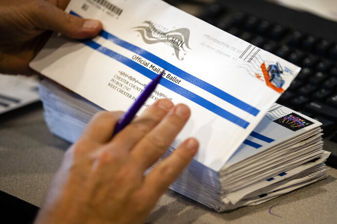 Dave Turnier processes mail-in ballots at at the Chester County Voter Services office in West Chester, Pa., prior to the primary election, Thursday, May 28, 2020. (AP Photo/Matt Rourke)