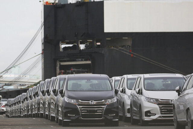 Cars wait to be exported at Yokohama port, near Tokyo, Tuesday, Sept. 29, 2020. Japan's exports fell more than 4% from a year earlier in November, despite an uptick in trade with China, according to customs data released Wednesday, Dec. 16. Exports of vehicles, semiconductors and other manufactured items showed the biggest declines.(AP Photo/Koji Sasahara)