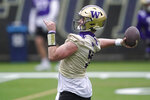 Washington quarterback Dylan Morris throws a pass during the first day of NCAA college football practice for the team, Wednesday, April 7, 2021, in Seattle. (AP Photo/Ted S. Warren)