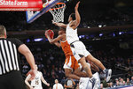 California guard Matt Bradley, right, defends Texas guard Matt Coleman III during the second half of an NCAA college basketball game in the 2K Empire Classic, Friday, Nov. 22, 2019, in New York. Texas defeated California 62-45. (AP Photo/Kathy Willens)