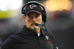 Atlanta Falcons head coach Dan Quinn stands on the sidelines during the first half of an NFL football game against the Seattle Seahawks, Sunday, Oct. 27, 2019, in Atlanta. (AP Photo/John Amis)