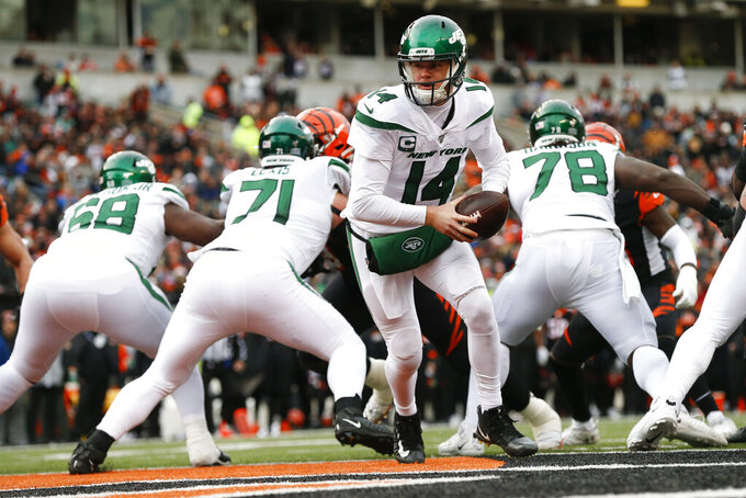 New York Jets quarterback Sam Darnold (14) looks to hand off the ball during the second half of an NFL football game against the Cincinnati Bengals, Sunday, Dec. 1, 2019, in Cincinnati. (AP Photo/Gary Landers)