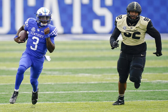 Kentucky quarterback Terry Wilson (3) runs with the ball during the first half of an NCAA college football game against Vanderbilt, Saturday, Nov. 14, 2020, in Lexington, Ky. (AP Photo/Bryan Woolston)