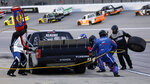 Josh Reaume pits during the NASCAR Truck Series auto race at Kansas Speedway in Kansas City, Kan., Friday, May 10, 2019. (AP Photo/Colin E. Braley)