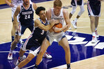 Gonzaga guard Andrew Nembhard (3) battle for a rebound with BYU forward Matt Haarms, right, in the first half during an NCAA college basketball game Monday, Feb. 8, 2021, in Provo, Utah. (AP Photo/Rick Bowmer)