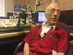 FILE - In this Oct. 9, 2018, file photo, DJ Art Laboe sits in his Palm Springs, Calif., studio and talks about his 75 years in the radio business. Laboe, 94, and