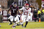 Arkansas quarterback Feleipe Franks (13) rushes for a first down against Texas A&M during the first quarter of an NCAA college football game Saturday, Oct. 31, 2020, in College Station, Texas. (AP Photo/Sam Craft)