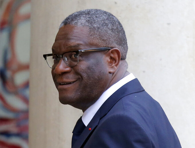 FILE - in this Monday, Oct. 29, 2018 file photo, Nobel Peace Prize 2018 winner Doctor Denis Mukwege of Congo arrives at the Elysee Palace in Paris, France, to meet France's President Emmanuel Macron. Nobel Peace Prize laureate Dr. Denis Mukwege has stepped down Wednesday, June 10, 2020 from a COVID-19 task force in eastern Congo, saying his hospital needs to focus on treating coronavirus patients because testing delays and other problems have allowed the crisis to deepen. (AP Photo/Michel Euler, File)