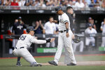 New York Yankees' Aaron Judge, left, and Aaron Hicks celebrate after scoring on a single by Gary Sanchez during the seventh inning of a baseball game against the Boston Red Sox in London, Sunday, June 30, 2019. (AP Photo/Tim Ireland)