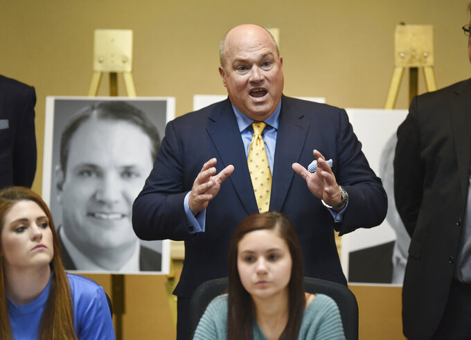 Attorney John Manly speaks of former University of Michigan doctor Robert E. Anderson as victims speak to the news media in Ypsilanti, Mich., Thursday, March 5, 2020. Dr. Larry Nasser survivors Sterling Riethman, left, and Kaylee Lorincz gave their support to the victims of Dr. Robert E. Anderson. (Max Ortiz/Detroit News via AP)